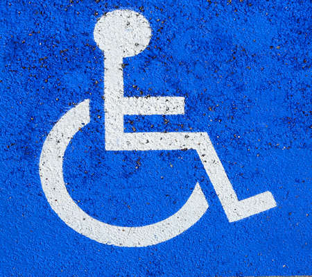 parking car with wheelchair symbol on blue background