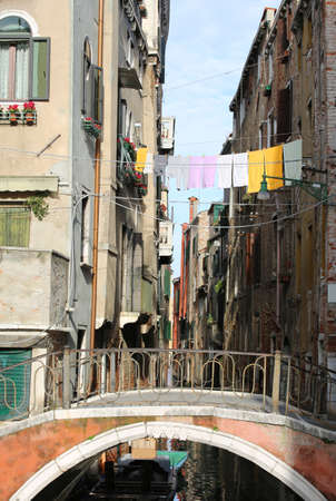 old bridge and hanging clothes in Venice in Italy Stock Photo
