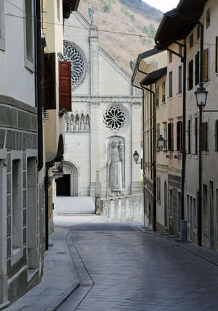 narrow street and the Cathedral of Gemona Town in Northern Italy