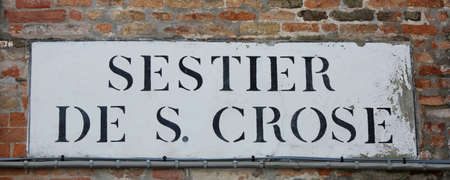 Road sign that means Saint Crux District in Italian Language in Venice Italy. The name Sestier means neigborhood
