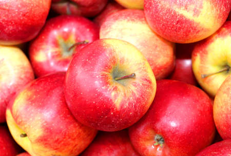 background of red apples for sale in the greengrocers shop