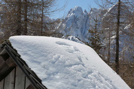 landscape with mountains and the roof of a small chalet Stock Photo