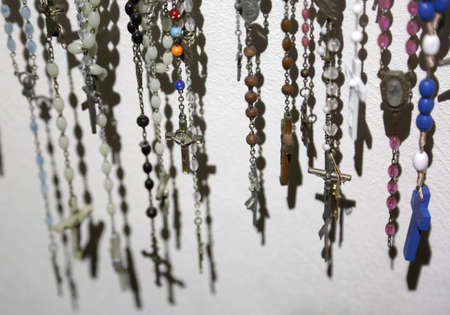 many crucifixes and crosses with shadows to pray in the church Stock Photo