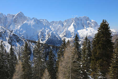 Many mountains called Carnic Alps in Italy with snow