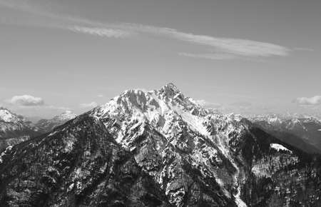 high mountain with snowed on the peak in Northern Italy in winter with black and white effect