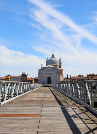 long pedestrian bridge made of boats to go to pray in the church called MADONNA DELLA SALUTE on the island of Venice in Italy