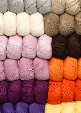 balls of wool of many colors lined up and arranged neatly in a large tailoring