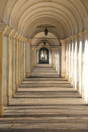 very long ports with the light that filters from the arches in neoclassical style Stock Photo