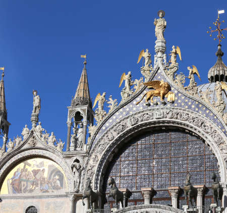 big golden winged lion symbol of the city of Venice on the Basilica of Saint Mark Stock Photo