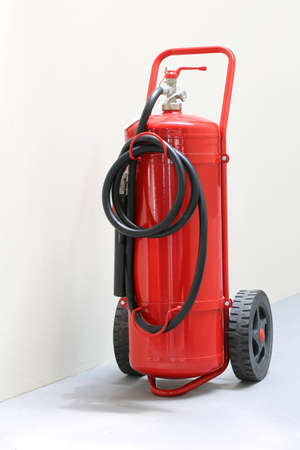 red fire extinguisher ready in case of emergency fire in a public building Stock Photo