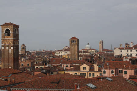red brick roofs of houses, domes and church bell towers of an Italian art city