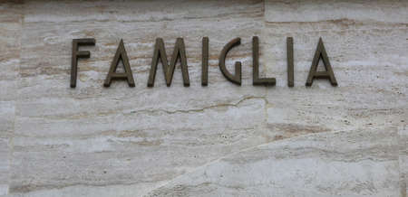 big text FAMIGLIA that means famiyl in Italy Language with copy space Stock Photo