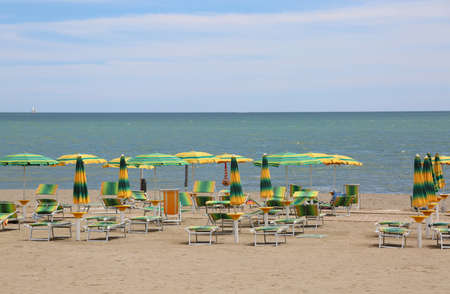umbrellas on the beach without people facing the calm sea