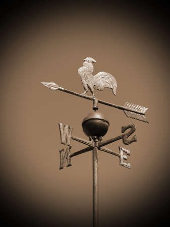 vintage weathercock also called weathervane with sepia toned effect