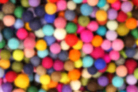 defocused background of many little balls. Intentional blur