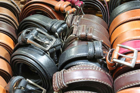 many belts of leather for sale in the italian store