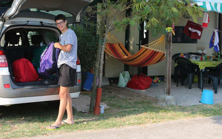 guy loads the car with many suitcases before departure to get home