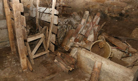 interior of an old mountain barn with various wooden tools