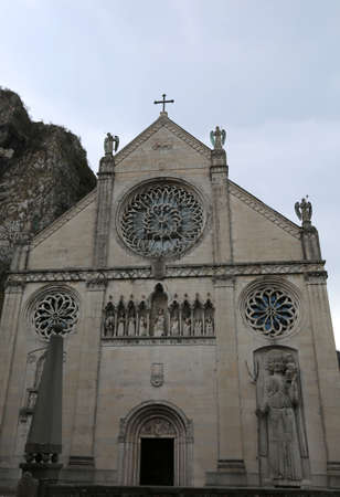 facade of old Cathedral in Gemona del Friuli in Northern Italy. The Church was destroyed by an earthquake in 1976