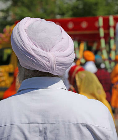 old sikh man with pink turban