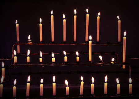 candles with flames during religion mass in the church