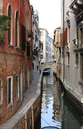 Many houses near the narrow water way in Venice Italy Stock Photo