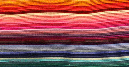 many lines of fabric of many colors for sale in the haberdashery