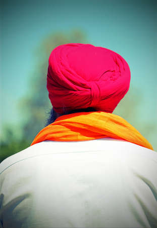 senior sikh man with turban on his head and white shirt with vintage effect
