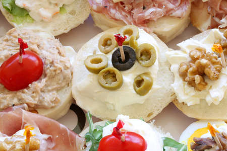 many sandwiches with olives and sauces at canteen Archivio Fotografico