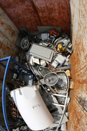 white water heater broken into a garbage container