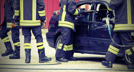 firefighters release a motorist trapped in the car after an accident