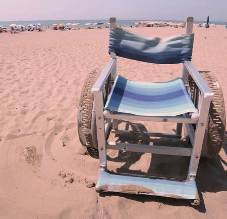 special Wheelchair with stainless steel wheel to go on the sand of the beach