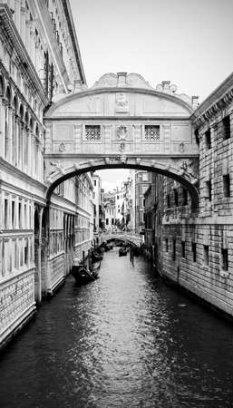 Venice in Italy Bridge of Sighs and ancient Ducal Palace with black and white effect