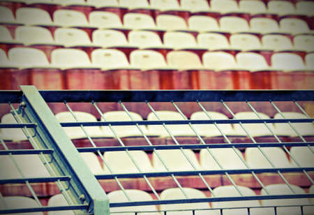 metal mesh in the stadium to divide the fans on the stairs from the players during the sports events with old vintage effect