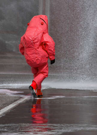 fireman with red protective gear against biological risk