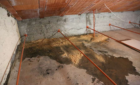 wide attic with dampness under the roof and the water Stock Photo