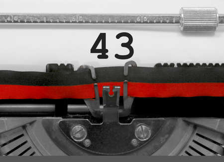 43 Number text written by an old typewriter on white sheet