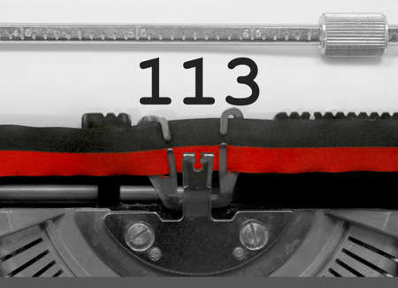 113 Number text written by an old typewriter on white sheet Stock Photo