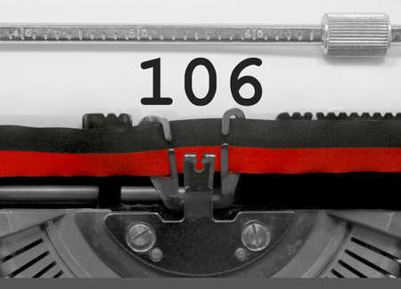 106 Number text written by an old typewriter on white sheet Stock Photo
