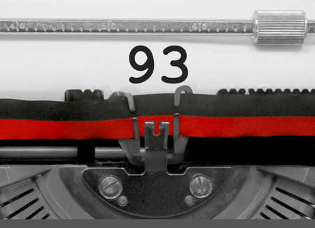 93 Number text written by an old typewriter on white sheet Stock Photo