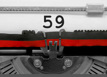 59 Number text written by an old typewriter on white sheet