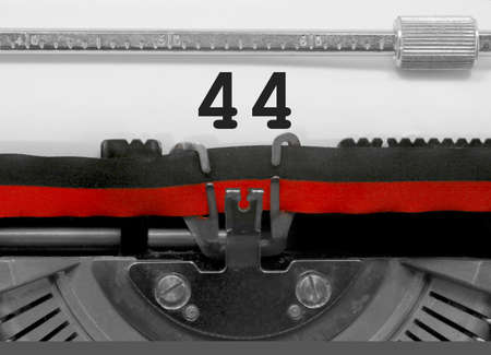 44 Number text written by an old typewriter on white sheet Фото со стока