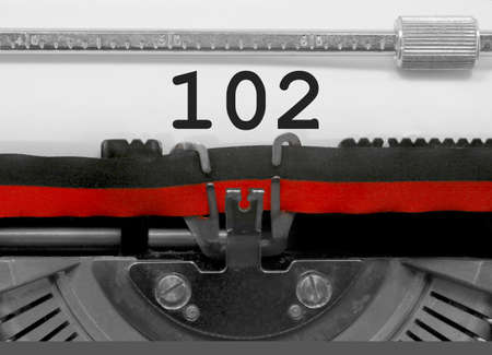 102 Number text written by an old typewriter on white sheet Stock Photo