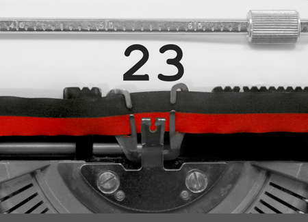 23 Number text written by an old typewriter on white sheet Stock Photo