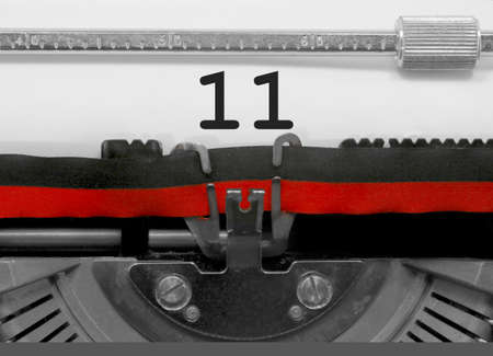 11 Number text written by an old typewriter on white sheet