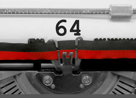 64 Number text written by an old typewriter on white sheet Stock Photo