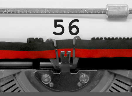 56 Number text written by an old typewriter on white sheet Stock Photo