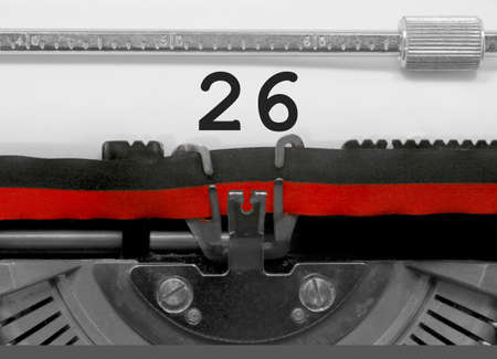 26 Number text written by an old typewriter on white sheet Stock Photo