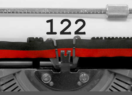122 Number text written by an old typewriter on white sheet