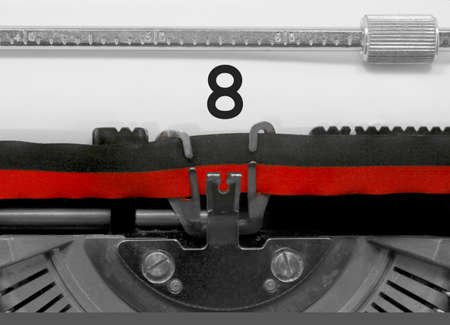 8 Number text written by an old typewriter on white sheet Stock Photo